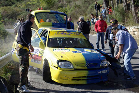sanremo: Sanremo, Italy October 12, 2013: 55th edition of the Sanremo Rally, European Rally Championship Citroen Racing Trophy, Trophy Gordini Twingo R2. A. Zerbini driver and co-driver S. Gallotti crashed his car Citroen Saxo A6 During the ascent to the mountain