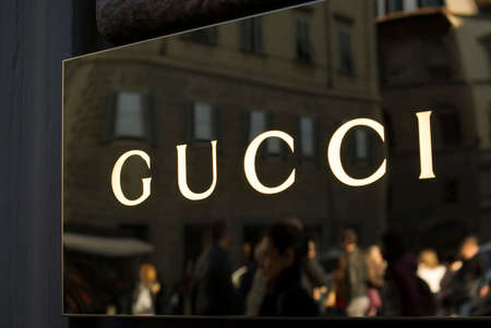 gucci store: Florence, Italy - October 31, 2015: Gucci store sign located in Via Tornabuoni, Florence the shopping street par excellence, with shops and boutiques of the most prestigious Italian and international fashion brands Editorial