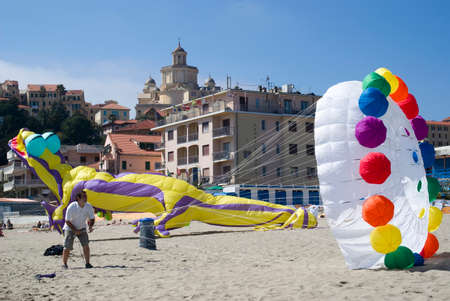 man flying: Imperia, Italy - April 2, 2011: Man flying kite During The International Kite Festival in Imperia