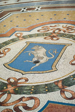 vittorio: Milan, Italy - March 8, 2016: Mosaic bull in the floor of the Vittorio Emanuele Gallery