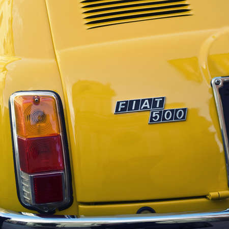 of yesteryear: Imperia, Italy - April 24, 2016: Close up detail of a Fiat 500 parked in a street in Imperia During the raid of vintage cars