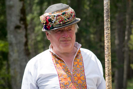 ukrainian ethnicity: Bukovel, Ukraine - May 21, 2016: Man wearing traditional Hutsul costumes of western Ukraine. Hutsuls, who are an ethno-cultural group of Ukrainian highlanders who for centuries have inhabited the Carpathian mountains, Mainly in Ukraine
