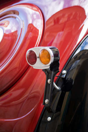 yesteryear: Imperia, Italy - April 24, 2016: Close up detail of car tail light of Fiat Topolino parked in a street During the raid of vintage cars