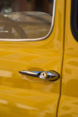 yesteryear: Imperia, Italy - April 24, 2016: Close up detail of Fiat 500 parked in a street in Imperia During the raid of vintage cars