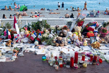tragedies: Nice, France - August 2, 2016: Makeshift memorials along the Promenade des Anglais in Nice to remember the victims of the terrorist attack of the 14th July 2016