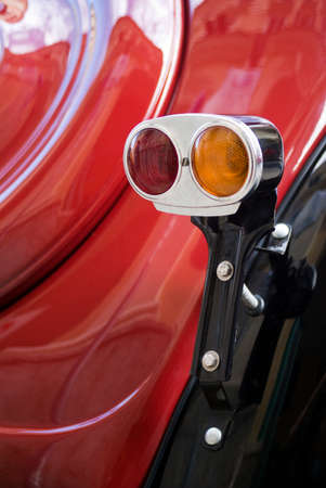 tail light: Imperia, Italy - April 24, 2016: Close up detail of car tail light of Fiat Topolino parked in a street During the raid of vintage cars