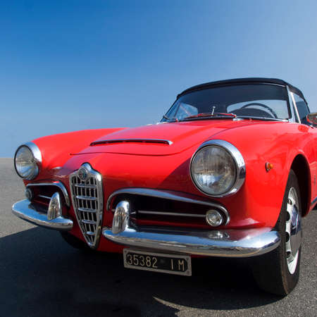 alfa: Imperia, Italy - July 29, 2016: Alfa Romeo Giulietta Spider cruising on the road in Imperia During the raid of vintage cars