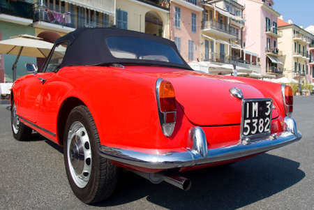 outside machines: Imperia, Italy - July 29, 2016: Close up detail of the Alfa Romeo Giulietta Spider parked in a street in Imperia During the raid of vintage cars