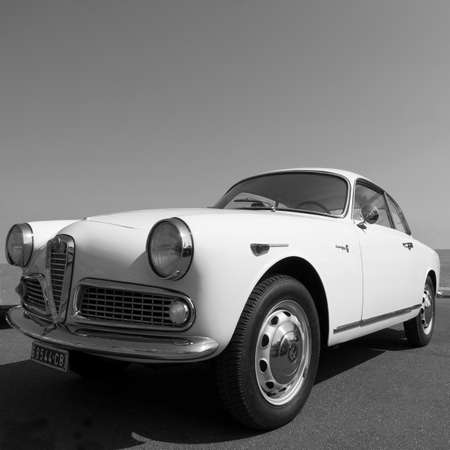 yesteryear: Imperia, Italy - July 29, 2016: Alfa Romeo Giulietta cruising on the road in Imperia During the raid of vintage cars