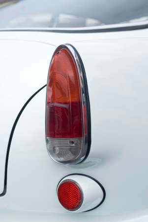 alfa: Imperia, Italy - July 30, 2016: Close up detail of car tail light of Alfa Romeo Giulietta parked in a street During the raid of vintage cars Editorial