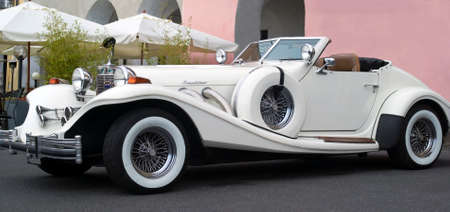 yesteryear: Imperia, Italy - July 30, 2016: Excalibur Phaeton Series IV cruising on the road in Imperia During the raid of vintage cars Editorial
