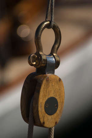 Image of closeup of pulley and rope on old sailing ship