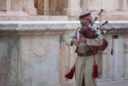 bagpipe: Jerash, Jordan � � October 24, 2016: Military bagpipe player perform for tourists at the South Theatre in Jerash, Jerash Editorial