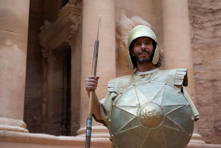 nabatean: Petra, Jordan - October 26, 2016: Nabatean soldier in front The Treasury building at Petra, Jordan