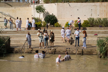 baptized: Qasr el Yahud, Israel - October 29, 2016: Religious Christians Themselves plunged into the waters of the Jordan River baptismal site of Qasr el Yahud in Israel. The baptismal site on the banks of the Jordan River, is the site where according to Functional