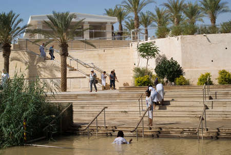 baptismal: Qasr el Yahud, Israel - October 29, 2016: Religious Christians Themselves plunged into the waters of the Jordan River baptismal site of Qasr el Yahud in Israel. The baptismal site on the banks of the Jordan River, is the site where according to Functional