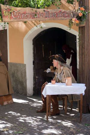 Taggia, Italy - February 26, 2017: Participant of medieval costume party in the historic city of Taggia in Liguria region of Italy. The actors acting out episodes of daily life in settings that evoke moments of life lived fully the seventeenth century. Th