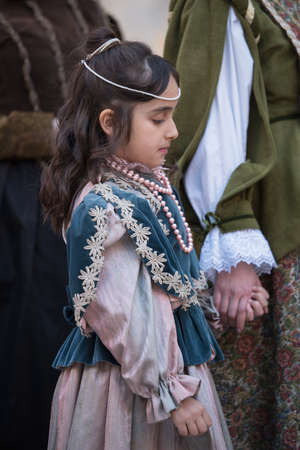 Taggia, Italy - February 26, 2017: Close-up of participant the medieval costume party in the historic city of Taggia in Liguria region of Italy. The actors acting out episodes of daily life in settings that evoke moments of life lived fully the seventeent