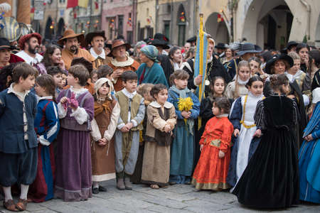 Taggia, Italy - February 26, 2017: Participants of medieval costume party in the historic city of Taggia in Liguria region of Italy. The actors acting out episodes of daily life in settings that evoke moments of life lived fully the seventeenth century. T