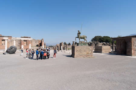 Pompei, Italy - March 29, 2017: School students visit Pompeii Archaeological site, UNESCO World Heritage Site, Campania region, Italy Editorial
