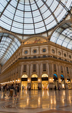 Milan, Italy - May 15, 2017: View of inside the Vittorio Emanuele II Gallery in the evening. Lombardy region, Italy, Europe Editorial