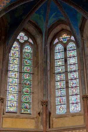of assisi: Assisi, Italy - March 15, 2017: Stained glass window. Basilica of Saint Francis of Assisi, (UNESCO World Heritage List), Umbria, Italy