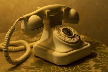 Classic push button desk telephone in retro style Stock Photo