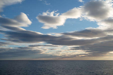 Dark cumulus clouds hovering over the sea Stock Photo