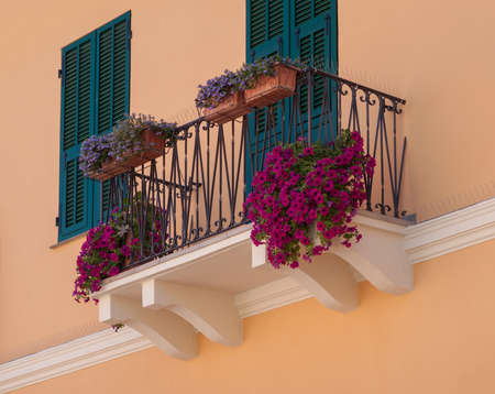 Italy, Imperia, Liguria region, View of balcony with flowers