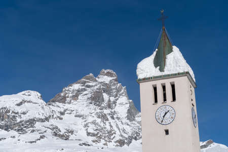 Breuil-Cervinia, Aosta Valley, Italy. Bell tower with Mount Cervino in background