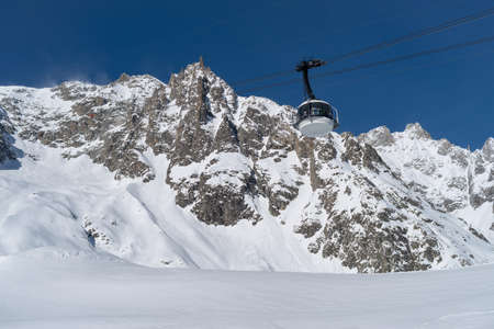 Courmayeur, Italy - January 23, 2018: The cable car (Skyway Monte Bianco) on the Italian side of Mont Blanc massif. The Skyway connects the city of Courmayeur to Pointe Helbronner (3,466 m)
