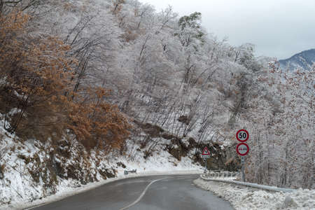 Alpine winter road after the ice storm Stock Photo