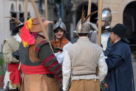 Taggia, Italy - March 17, 2018: Participants of medieval costume party in the historic city of Taggia in Liguria region of Italy. The actors acting out episodes of daily life in settings that evoke moments of life lived fully the seventeenth century. The