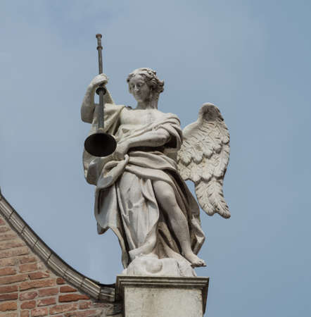 Angel holding a trumpet on the facade of Cremona Cathedral, Lombardy region, Italy Stok Fotoğraf - 110230060