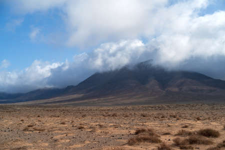 Desert stone volcanic landscape in Lanzarote, Canary Islands. Hacha Grande mountain, in the south of the island