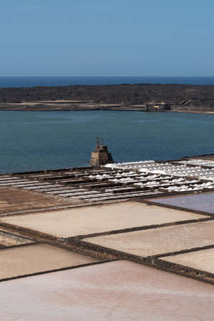 Natural salt evaporation pond on the island of Lanzarote at Salinas de Janubio, Canary Islands, Spain