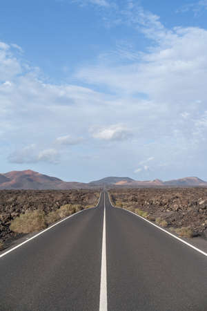 Road going through wilderness area in Timanfaya National Park, Lanzarote, Canary Islands, Spain