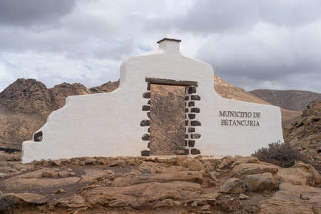 Typical boundary sign beside the road welcoming visitors to the Municipality of Betancuria, Fuerteventura, Canary Islands, Spain