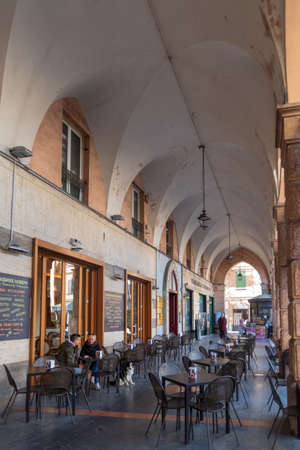 Sanremo, Italy - March 13, 2019: Pedestrian street  in the old town of Sanremo, seaside city on the Italian Riviera
