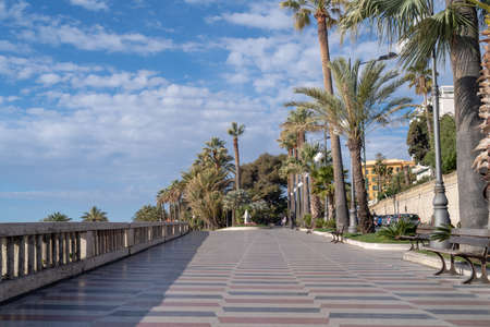 Sanremo, Italy. Promenade of the Empress (Corso Imperatrice) flanked by palm trees, alongside the sea Reklamní fotografie