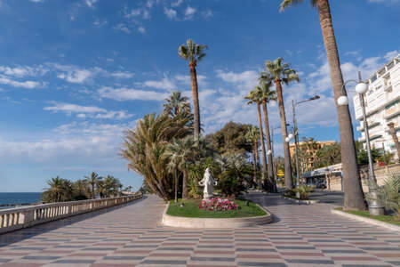 Sanremo, Italy. Promenade of the Empress (Corso Imperatrice) flanked by palm trees, alongside the sea Imagens
