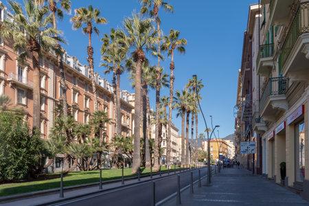 Sanremo, Italy - March 19, 2019: Street in Sanremo historic centre, seaside city on the Italian Riviera