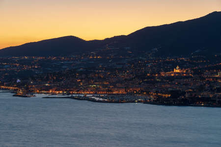 Sanremo by night. Liguria region, Italy 免版税图像