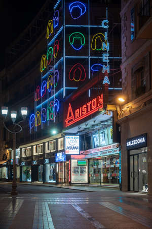 Sanremo; Italy - March 19; 2019: Facade view by night of Ariston Theatre in Sanremo in pedestrian main street G.Matteotti. The theater has been the home of the annual Sanremo Music Festival Competitions; since 1977