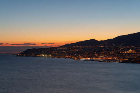 Italy. Ligurian coastline along Sanremo city at evening light Фото со стока