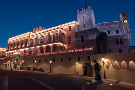 Monaco-Ville, Monaco - March 29, 2019: Night view of the Princes Palace - is the official residence of the Prince of Monaco
