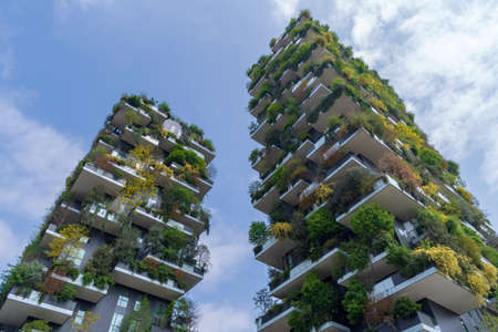Milan, Italy - April 13, 2019: The Vertical Forest (Bosco Verticale), residential towers in Porta Nuova district, near Milan Porta Garibaldi railway station. They have a height of 111 metres and 76 metres and contain more than 900 trees. Architect: Stefan