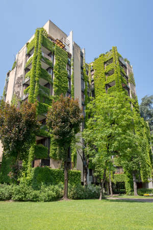 Milan, Italy - May 6, 2018: Apartment building with a large courtyard around the green neighborhood of Milan