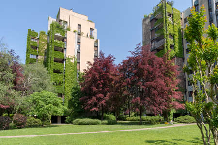 Milan, Italy - May 6, 2018: Apartment building with a large courtyard around the green neighborhood of Milan Editorial