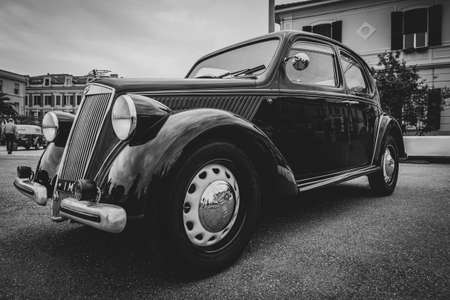 Imperia, Italy - May 19, 2019: Close up of Lancia Andrea Classic car parked in a street in Imperia during raid of vintage cars